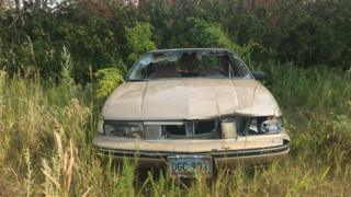 An abandoned car on the Spirit Lake Reservation