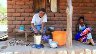 Women using cookstove in Malawi