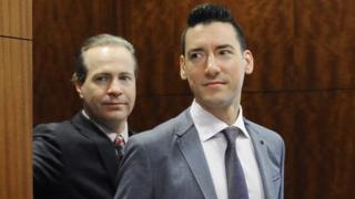 David Robert Daleiden, right, leaves a courtroom after a hearing in Houston.