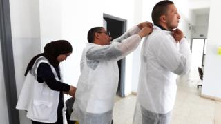 in_pictures Medics putting on protective gear in Tunis, Tunisia - Tuesday 7 April 2020