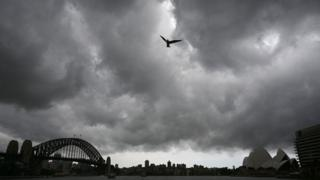 Storm clouds gather over Sydney Harbour on January 20