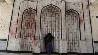 Woman at bloodstained wall