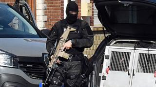 French anti-terror police on patrol in a street on Wattignies, northern France on 5 July