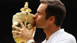 "Roger Federer of Switzerland kisses the trophy as he celebrates victory after the Gentlemen""s Singles final against Marin Cilic of Croatia on day thirteen of the Wimbledon Lawn Tennis Championships at the All England Lawn Tennis and Croquet Club at Wimbledon on July 16, 2017 in London, England"