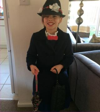 Here's 10-year-old Mya as Mary Poppins...