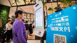 """A customer tries Alipay""""s facial recognition payment solution """"Smile to Pay"""" at KFC""""s new KPRO restaurant in Hangzhou, Zhejiang province, China September 1, 2017"""