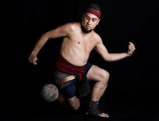 "Mexican Enrique Villegas, player of a pre-Columbian ballgame called ""Ulama"" -in Nahuatl indigenous language- poses for a photograph hitting a ""Ulamaloni"" (solid rubber ball) with his hip, during a photo session at the FARO Poniente cultural centre in Mexico City on August 21, 2019"