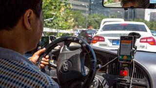 Conductor con la aplicación Didi Chuxing