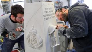 Prisoners carving a war memorial