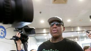 Dennis Rodman mobbed by the press en route to Pyongyang