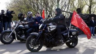 Night Wolves leader Aleksandr Zaldostanov (right, on a bike) his colleagues before the start of their rally in Moscow, Russia. Photo: 29 April 2016
