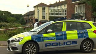 Police at Exeter House, Feltham