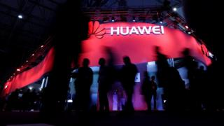 """Visitors walk past Huawei""""s booth during Mobile World Congress in Barcelona, Spain, February 27, 2017. REUTERS/Eric Gaillard/File Photo"""
