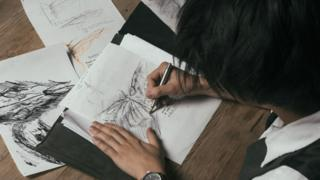 Frank To working on one of his drawings
