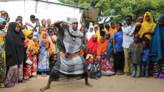 A woman dancing at a wedding in Mogadishu, Somalia in August 2016