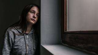 A stock picture of a teenager with mental health issues