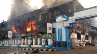 A local parliament building burns during a protest in Manokwari, West Papua, Indonesia