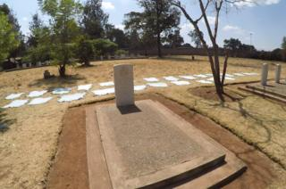 Kairokor cemetery in Nairobi where cow hides surround the memorial.
