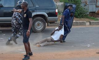 "Anti riot policeman drags away a supporter of Sierra Leone People""s Party (SLPP) during a protest against the police attempting to search the offices of Julius Maada Bio, the presidential candidate for (SLPP) in Freetown, Sierra Leone March 7, 2018."