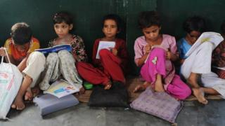 In a picture taken on August 30, 2012, Indian school children read in a classroom at a government school in Bagpath district in Uttar Pradesh.