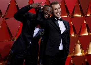 Aldis Hodge (left) and Glen Powell