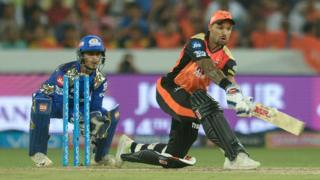Shikhar Dhawan (right) plays a shot for IPL team Sunrisers Hyderabad