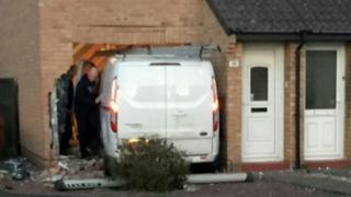 Van crashed into house