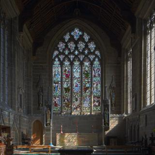 The stained glass window at St John the Baptist Church in the village of Tideswell in Derbyshire