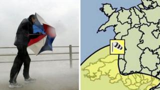 A man with an umbrella in the wind with a weather map