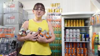 Emma Forrest with her fizzy drinks and energy drinks at home