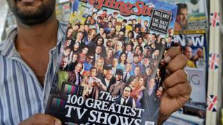 Vendedor con la revista Rolling Stone