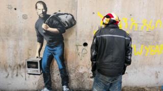 Banksy artwork at the Jungle refugee camp showing Steve Jobs