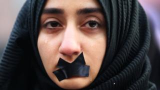 A Turkish student cries during a protest to show solidarity with trapped citizens of Aleppo, Syria, in Sarajevo, Bosnia