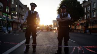 Police guard a street in Finsbury Park after a vehicle hit pedestrians