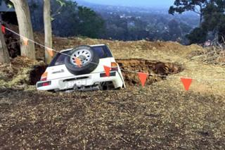 A small Suzuki 4WD fell into a sinkhole in the Adelaide Hills