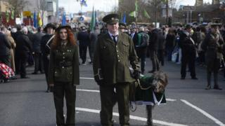 An Irish wolfhound led the parade in west Belfast