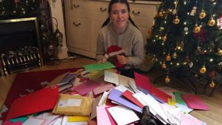 Holly Benbow, 18, surrounded by her cards