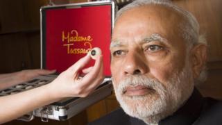 Narendra Modi models for his wax statue