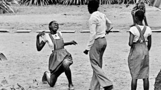 "A photo by Sunmi Smart-Cole entitled: ""Teacher Brutality"" - 1984, showing a student being flogged in Nigeria"