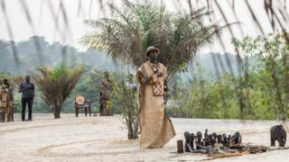 """A spiritual leader of the """"Eglise des Noirs"""" known as The Messengers of the Ancestors, performs rituals during a gathering outside Kinshasa"""