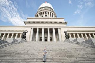 Eusebio Leal delivers a speech in front of El Capitolio, the National Capitol Building, for the unveiling of the cover of the dome on August 30, 2019, in Havana, Cuba.