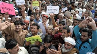 Pakistani demonstrators shout slogans during a protest against the execution of convicted murderer Mumtaz Qadri in Lahore on February 29, 2016
