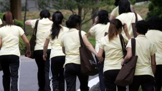 Image shows North Korean defectors walking at the South Korean Hanawon resettlement facility on July 8, 2009 in Ansung, South Korea