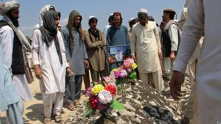 Afghan men attend the funeral of a victim of suicide car bomb attack at Camp Chapman in Karwan Sarai village in Khost province (13 July 2015)