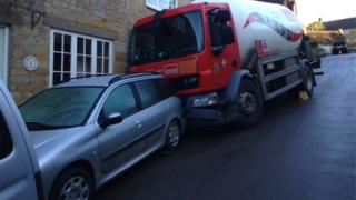 Tanker crashes into cars