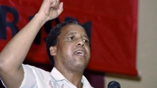 Chris Hani salutes delegates at the closure of their first congress inside South Africa in 41 years, in Soweto on 8 December 1991