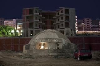 Bunker in Albania next to buildings