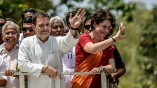 Rahul Gandhi and Priyanka Gandhi wave at the crowd in the road show after Rahul Gandhi filing nominations from Wayanad district on April 4, 2019 in Kalpetta town in Wayanand