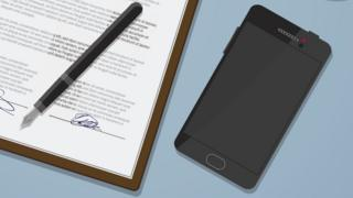 A mobile phone next to a document
