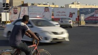 صور مرشحين في الانتخابات البحرينية
